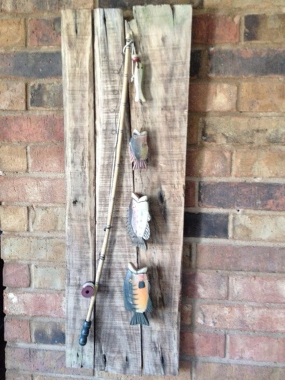 Rustic wooden fishing pole with wooden fish on by justmeandmom for Wooden fishing pole