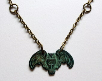 Owl necklace. Who, whoooooo. The vedigris finish owl suspended from an antiqued bronze chain. Lobster claw clasp.