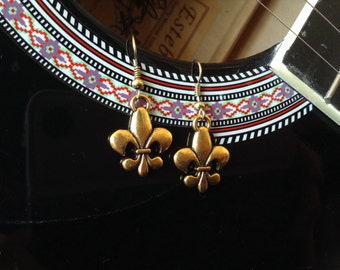 Gold toned metal Fleur de lis earrings