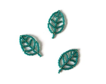 leaf ornaments made from green seed beads and wire, decorative beaded leaves, easter home decor, gift tags, decoration material