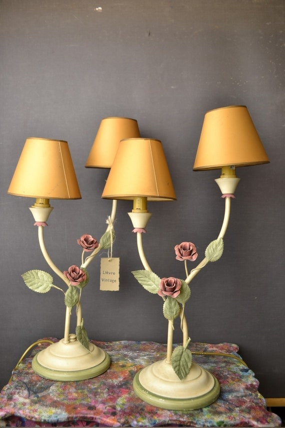 Standing tole flower lamp pair.