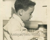 Cute boy playing piano antique art photo