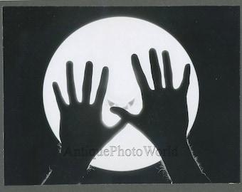 Hands over moon vintage abstract art photo D Hunsberger