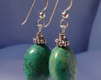 Real turquoise stone earrings set from sterling wire detailed with pewter accents