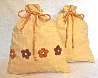 Travel lingerie bags - cream with crocheted flowers