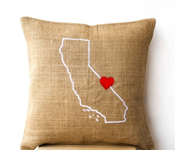 State in Words A state isn't just where you come from, or where you are making a new home for yourself--it's part of who you are. Designer Tracy Gemme 's location-loving pillows celebrate that complex attachment by bringing together cheerful typography, eco-friendly materials, familiar map silhouettes and straight-up, huggable pleasure.