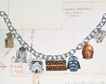 Star Wars Charm Bracelet featuring Yoda, R2D2, Storm Trooper, Darth Vader, C3PO, and Star Cruiser