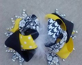 Black, white, and yellow bow