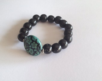 Stylish black wood beads bracelet and turquoise howlite with imprinted hibiscus flower pattern