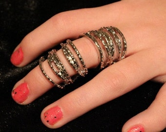 Beautiful Layer and layers of ring all in one cage knuckle ring