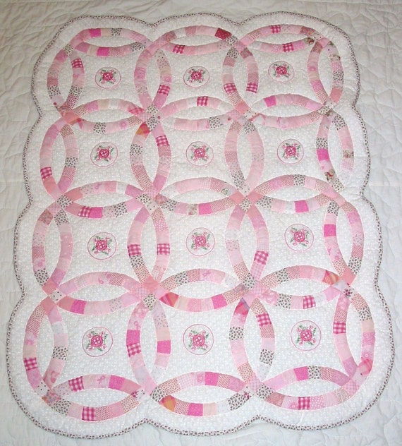 Double wedding ring crib size quilt machine embroidery of a