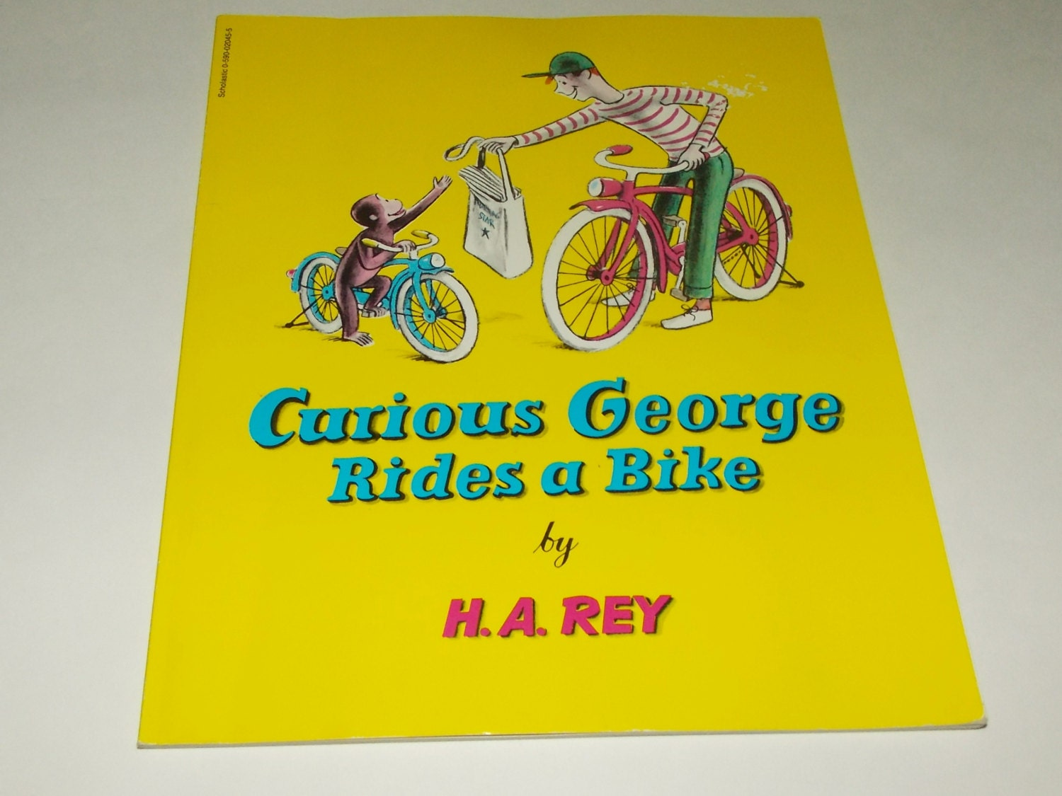 a review of ha reys book curious george rides a bike Books curious george learns the alphabet curlytops in a summer camp curious george ha rey curious if true strange  a pop up book curious george goes sledding.