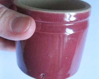 small plum coloured vintage stoneware storage jar
