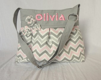 Pleated Diaper Bag large in pink and gray chevron and gray lining.  Adjustabe strap, elastic bottle pockets, option of 3 fabric flowers