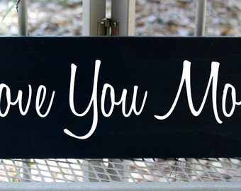 Love you more wood sign