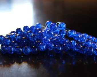 100 approx. dodger blue, 8 mm crackle glass beads, 1 mm hole, round and smooth