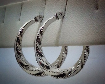 Vintage 14kt white gold one inch hoops.
