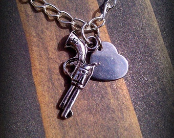Pistol and heart charm necklace