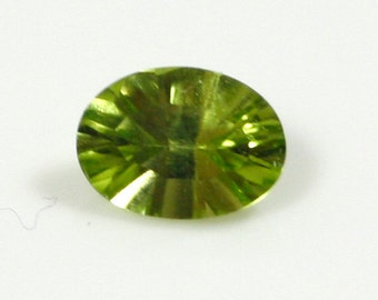 Oval Concave Cut Peridot - 5mm x 7mm