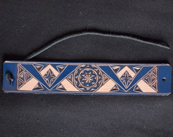 Carved leather bracelet