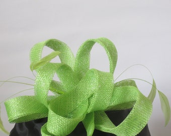 Lime green sinamay   loops on alligator clip .