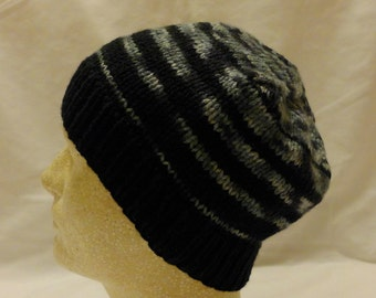 Ocelot Transitions ~ Hand knit beanie with transitions from black to multi-colored greys