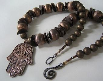 Shibuichi Hamsa: 'Shibuichi' alloy, brushed copper, anodized silver. Necklace and earring set.