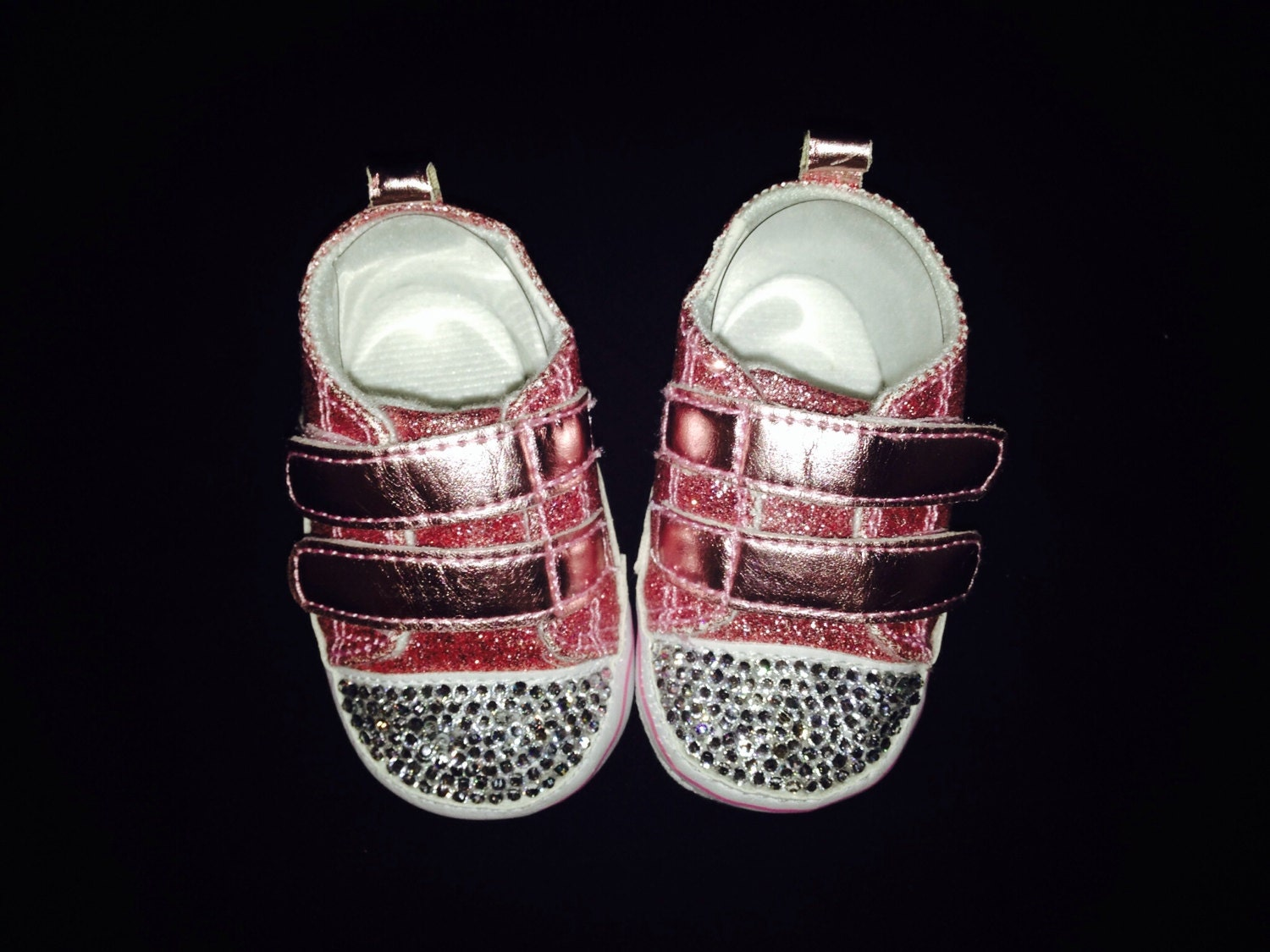 Adorable baby girl pink glitter shoes with the toes covered in