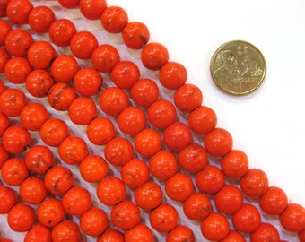 6mm Round Orange Coloured Howlite (Magnesite) Stone Strand