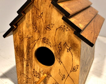 Birdhouse with woodburned design.