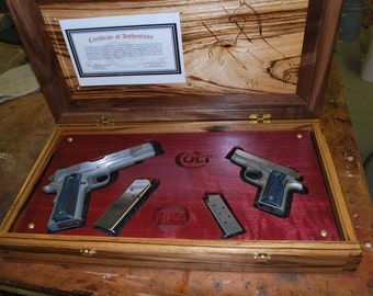 Pistol presentation case, custom made for two pistols.
