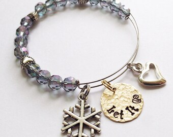 SALE Frozen inspired child's expandable bangle bracelet hand stamped with Let It Go disc charm, snowflake and heart charm purplegreen luster