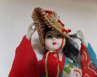 Hand made vintage Japanese Geisha style doll, intricate costume on wooden stand,