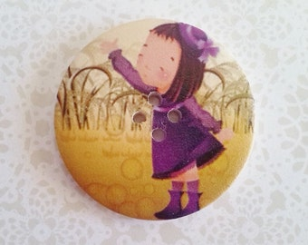 50mm button featuring a little girl in a purple dress shoes and hat