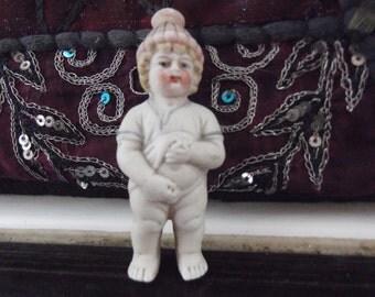 Antique novelty bisque weeing boy