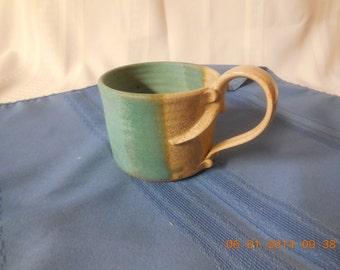Decorative ceramic coffee cup.