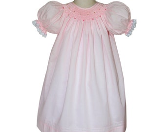 Delicate girls pink hand smocked bishop dress with lace.  Made by Carouselwear.  Made in 100% peruvian cotton, from size 3m to 6y.  17863