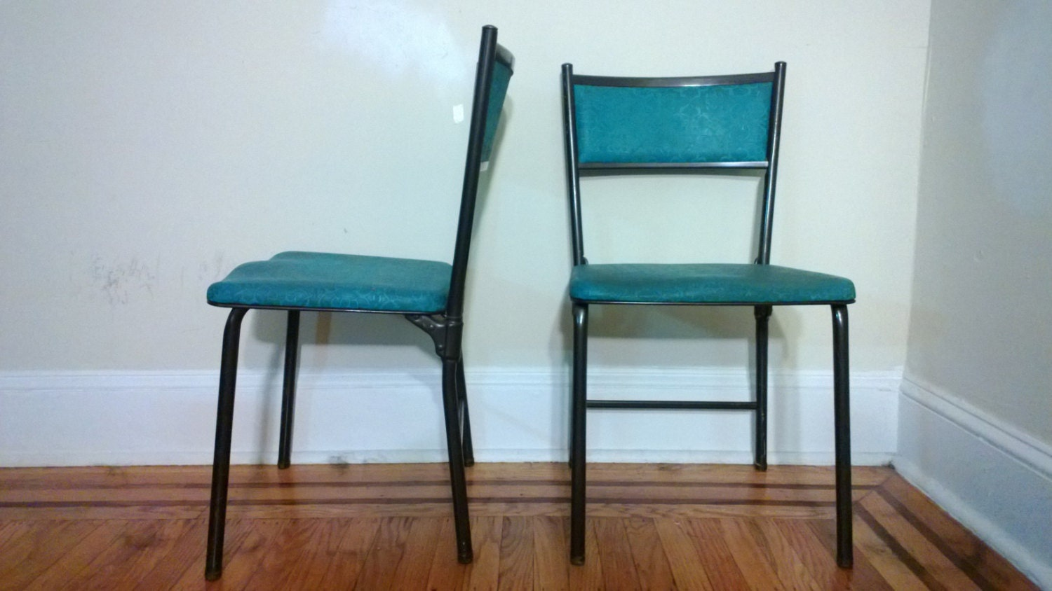 A pair of 1950 s Vintage Costco folding chairs