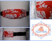 Orange and white floral insulin pump belt made with Jennifer Paganelli Girls World Vibe Carrie fabric with black elastic.  Size 2.