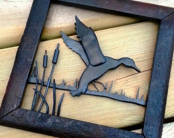 All steel duck scene landing in marsh with 100 year old wrought iron frame