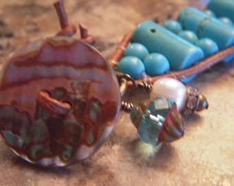 wrap bracelet with turquoise barrel beads and 6mm turquoise round beads, natural distressed leather