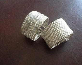 Beautiful 'cuff' bracelet fitting all sizes . Hand made