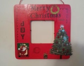 Homemade painted personal wood frame with 3d Christmas signs  on bottom