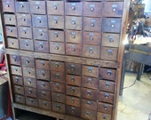 Antique Seventy Drawer Wood Apothecary Cabinet With Numbered Drawers