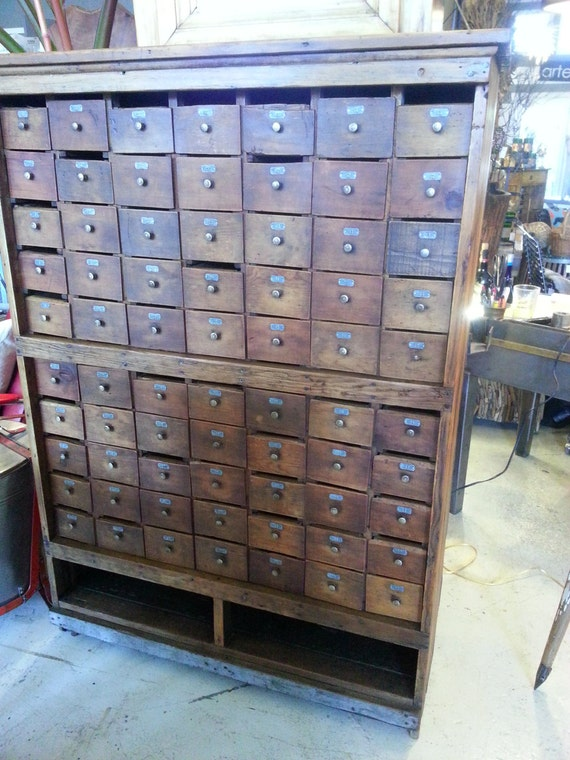 Antique Seventy Drawer Wood Apothecary Cabinet With Numbered