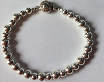 Sterling Silver Beaded Bracelet with Blue Topaz clasp