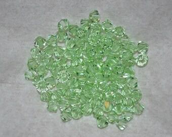 24 - 4mm Genuine Swarovski Crystal Beads - Chrysolite