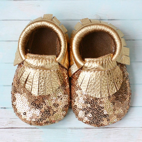 Buy Robeez Premium Leather Maggie Moccasins Gold Soft Soles now. Trust Robeez when shopping for the best baby shoes for the healthy feet of your infant and toddler. Select from our lines of famous soft sole shoes and baby mocassins as well as First Kicks and Mini Shoez.4/5(4).