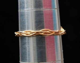 Ring. An Amethyst gold plated braided wrap ring.  UK ring size S ; US ring size 9 1/4