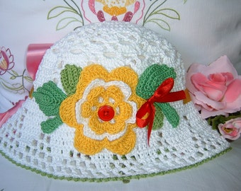 Crochet Baby Hat. White cotton hat with floral applications. Crochet girl fashion. Female romantic Hat